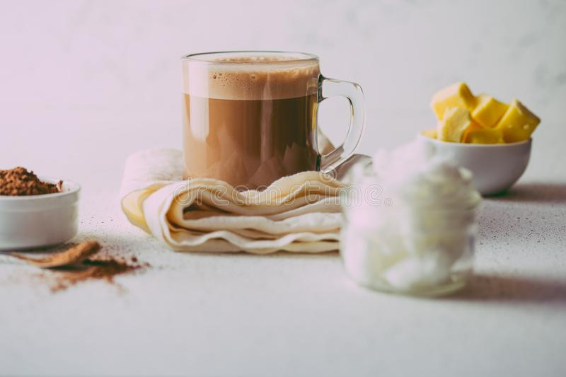 BULLETPROOF CACAO. Ketogenic keto diet hot drink. Cacao blended with coconut oil and butter. Cup of bulletproof cacao royalty free stock photo