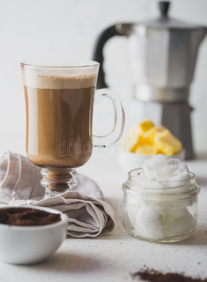 BULLETPROOF COFFEE. Ketogenic keto diet coffe blended with coconut oil and butter. Cup of bulletproof coffee and stock images
