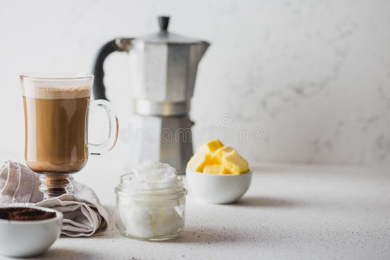 BULLETPROOF COFFEE. Ketogenic keto diet coffe blended with coconut oil and butter. Cup of bulletproof coffee and stock photos