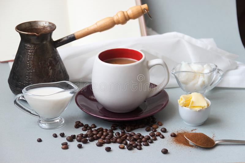 Bulletproof coffee recipe keto. it works ketogenic diet. On the background an open book with copy space for text. Bulletproof coffee recipe keto. it works stock photos