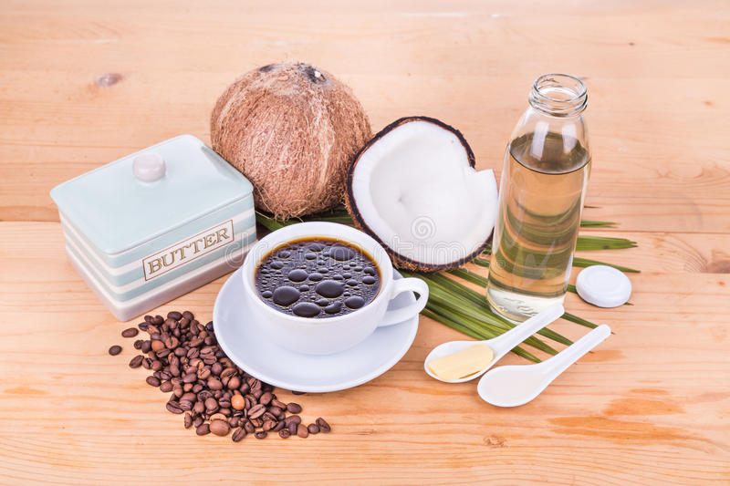 Bulletproof coffee with virgin coconut oil and organic butter. Bulletproof coffee with cold pressed extra virgin coconut oil and grass fed organic butter on stock photo