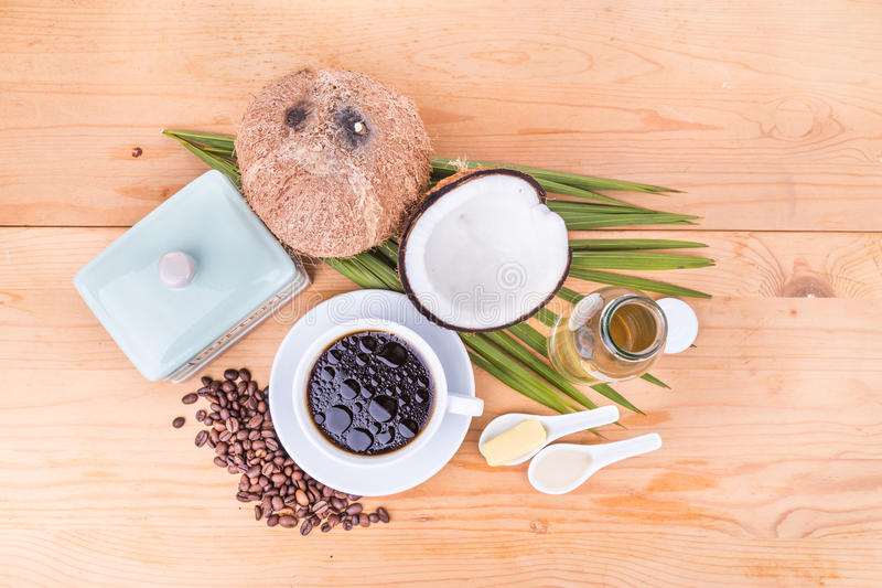Bulletproof coffee with virgin coconut oil and organic butter. Overhead view on bulletproof coffee with cold pressed extra virgin coconut oil and grass fed royalty free stock image