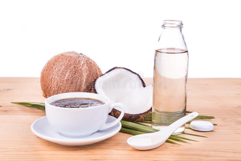 Bulletproof coffee with virgin coconut oil on wooden table. Bulletproof coffee with cold pressed extra virgin coconut oil on wooden table, part of ketogenic diet royalty free stock photography