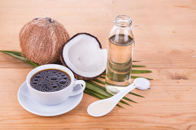 Bulletproof coffee with virgin coconut oil on wooden table. Bulletproof coffee with cold pressed extra virgin coconut oil on wooden table, part of ketogenic diet stock photo