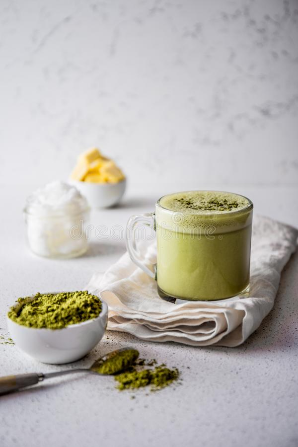 BULLETPROOF MATCHA. Ketogenic keto diet hot drink. Tea matcha blended with coconut oil and butter. Cup of bulletproof stock image