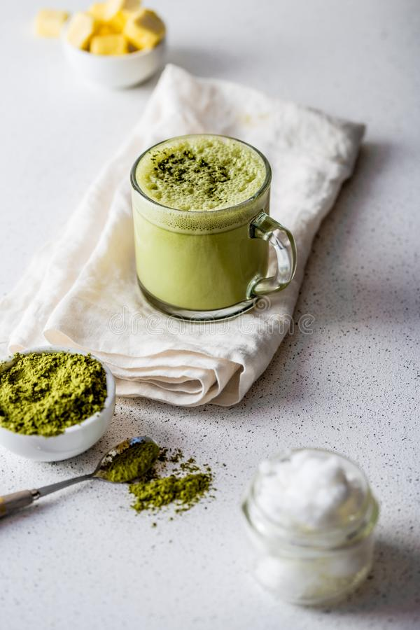 BULLETPROOF MATCHA. Ketogenic keto diet hot drink. Tea matcha blended with coconut oil and butter. Cup of bulletproof stock photography