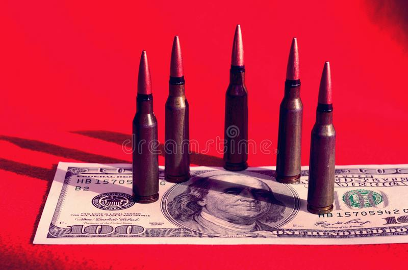 Bullets on dollar bills terrorism, war, Ukraine, armed conflict. Violence - concept royalty free stock photography