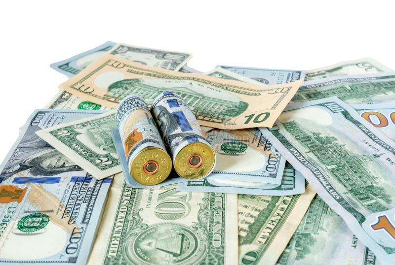 Bullets on dollar bills terrorism, war, Ukraine, armed conflict, violence concept. royalty free stock images