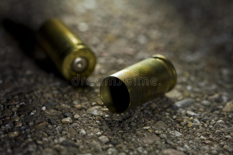 Bullets on the ground stock photos