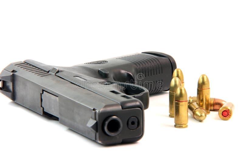 Bullets and gun royalty free stock photo