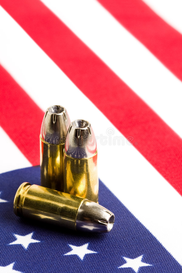 Bullets over US flag stock image