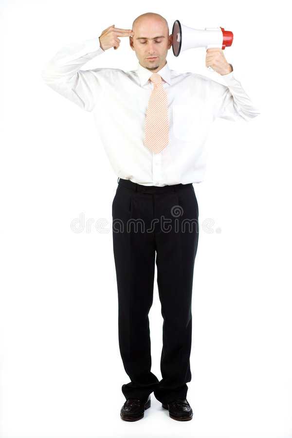 Bullhorn Effect. A shut eyed businessman isolated on a white background, holds a bullhorn to one ear and makes a 'gun-like' hand gesture to the temple on the stock photo
