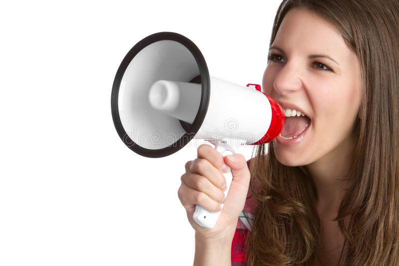 Bullhorn Woman. Young woman yelling into bullhorn royalty free stock photos