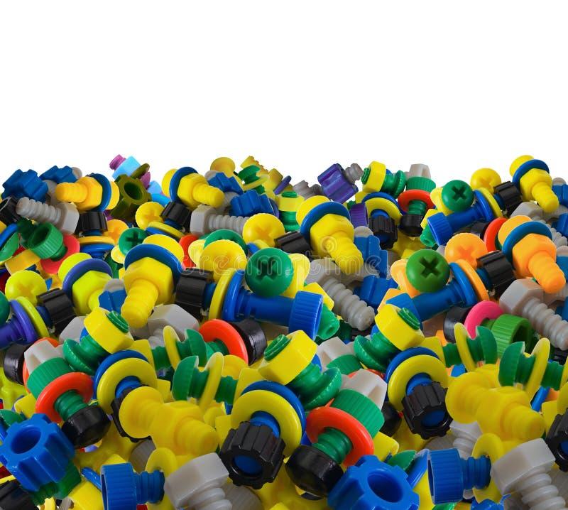 Bulloni e noci di plastica del giocattolo di colore fotografia stock