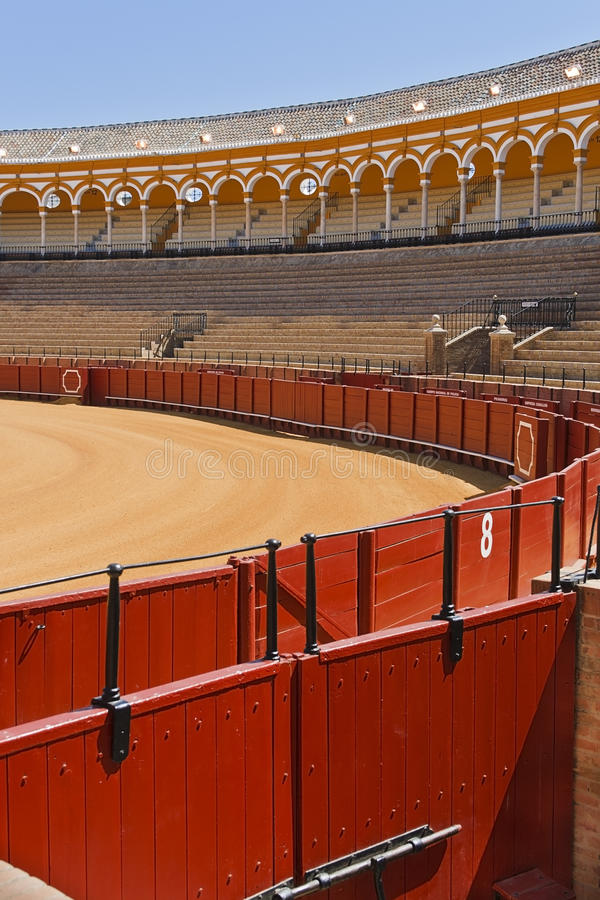 Bullring. Plaza de Toros. Detail of the bullring in Seville: the image shows the gate where the toreador leaves the bullring after victory. The signs indicate royalty free stock photos