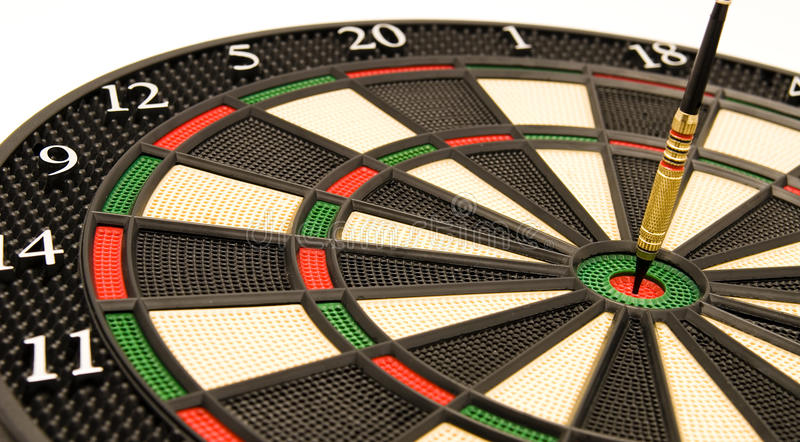 The Bulls Eye. Bulls Eye on an electronic Dart board on white depicting success and triumph through any challenge in business and life royalty free stock photos