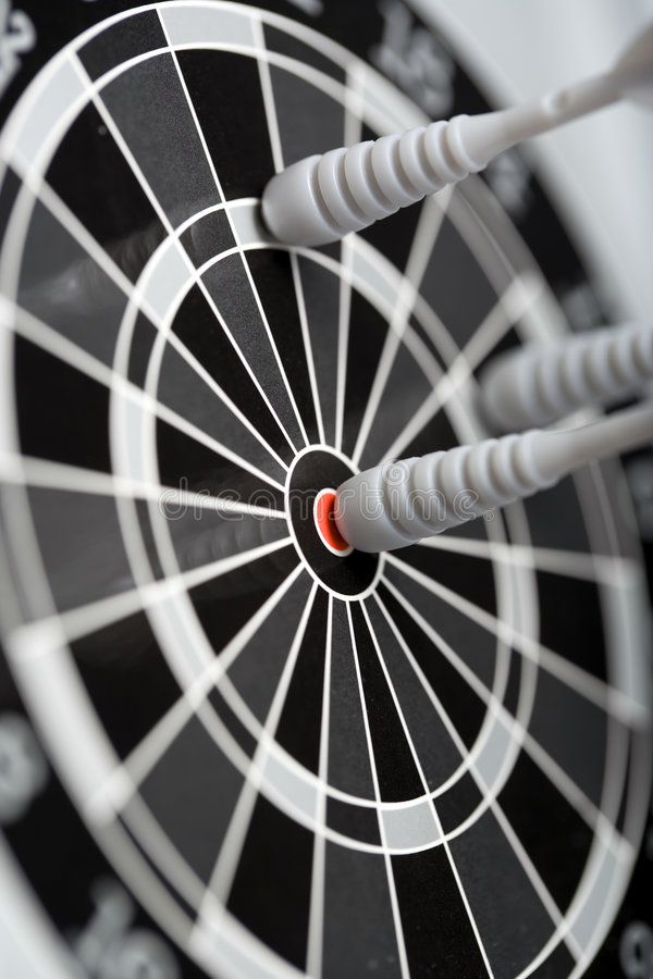 Bulls eye. Arrow in bulls eye of magnetic dartboard royalty free stock photo