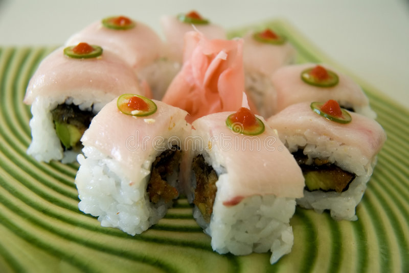 Bulls-eye sushi roll. On a spiral plate royalty free stock photography