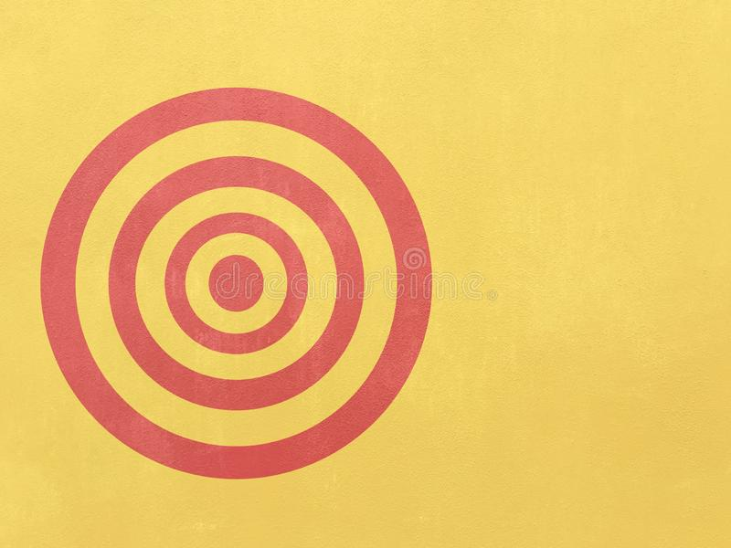 Bullseye target on yellow wall. Bullseye Red target on yellow wall empty space right side royalty free stock image