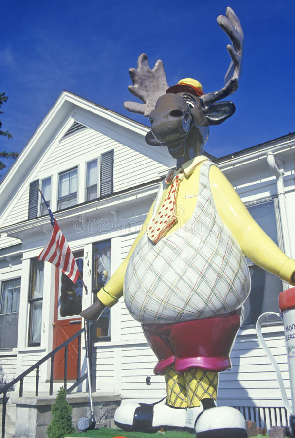 Bullwinkle the moose statue. In golf clothing as a lawn ornament, Gorham, NH royalty free stock photos