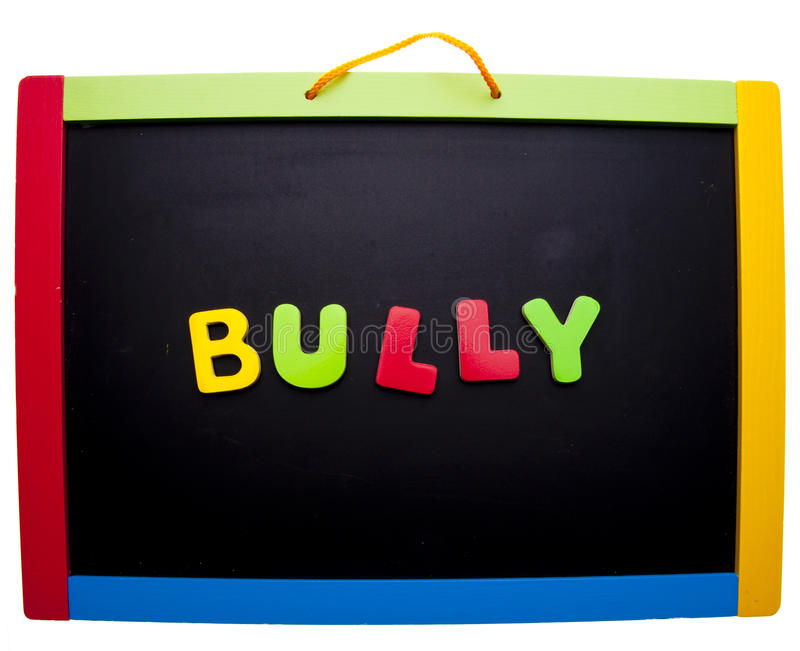 Bully. In bright letters on a school chalkboard isolated on white with a clipping path royalty free stock images