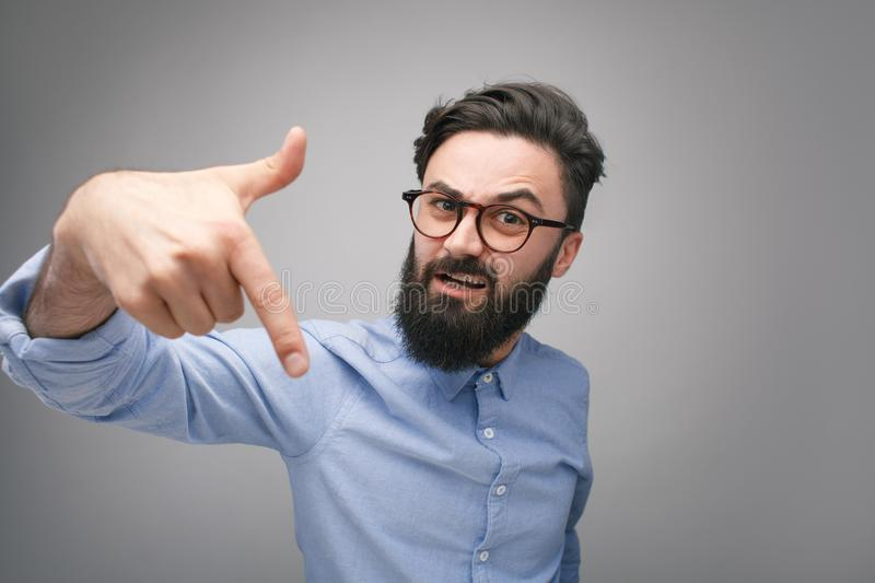 Bully man in glasses gesturing at camera royalty free stock photo
