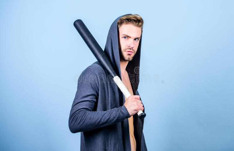 Bully mood. Bad boy concept. Man handsome bully guy with baseball bat. Sport equipment. Strong and confident. Aggression stock photo
