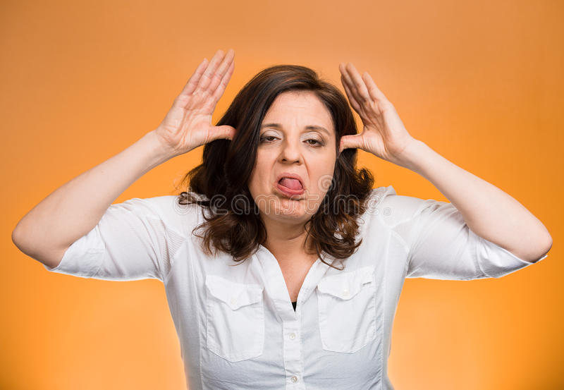 Bully woman sticking tongue out royalty free stock photos