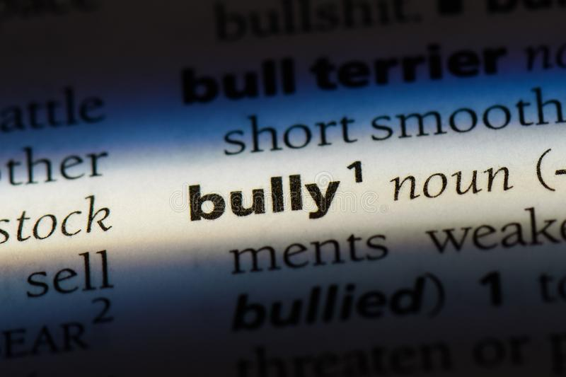 Bully. Word in a dictionary.  concept royalty free stock image