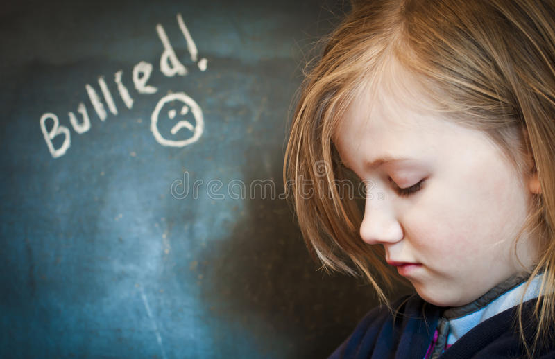 Bullying. A young victim of school bullying royalty free stock photo