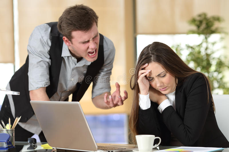 Bullying with a boss shouting to an employee stock photos