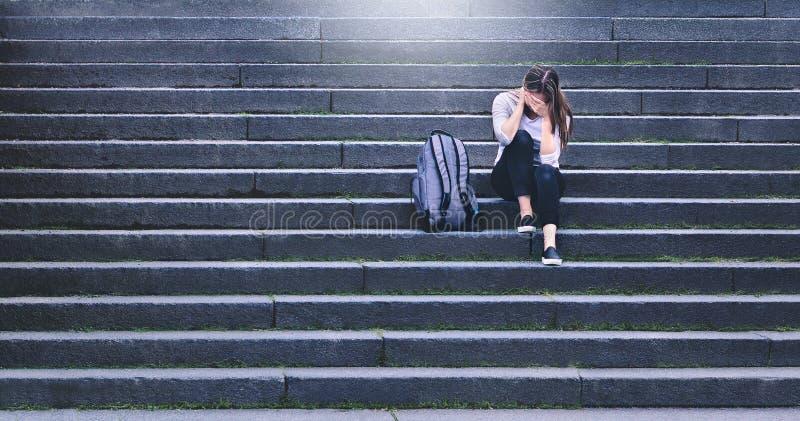 Bullying, discrimination or stress concept. Sad teenager crying. stock photos