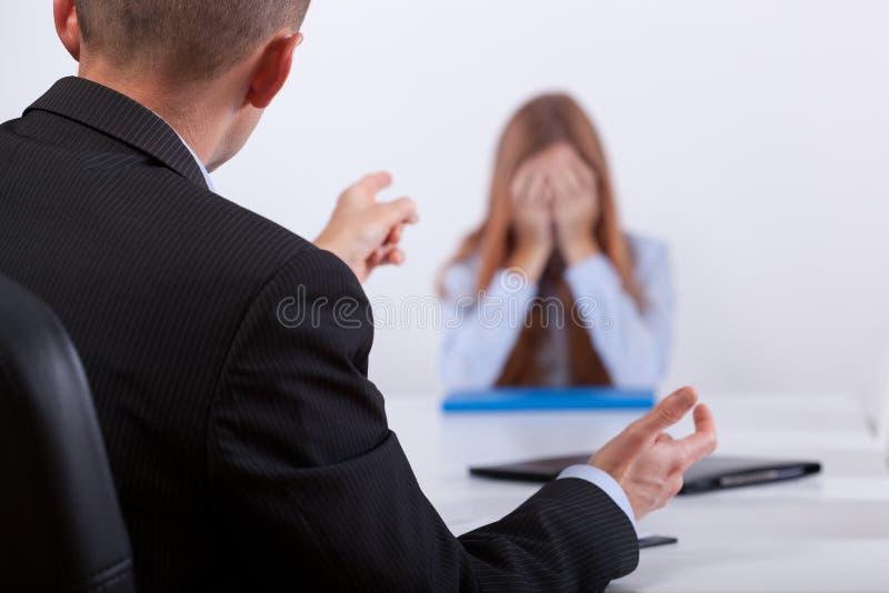 Bullying on the job meeting stock photos