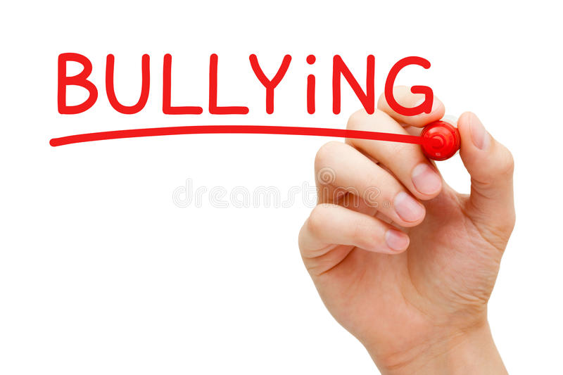 Bullying Red Marker. Hand writing Bullying with red marker on transparent wipe board royalty free stock image