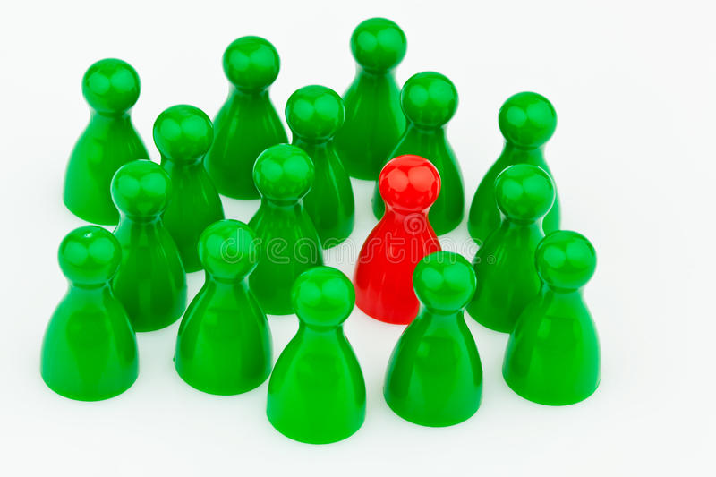 Bullying in the team. Outsider. Red and green characters. Bullying, loneliness and outsider in the team stock images
