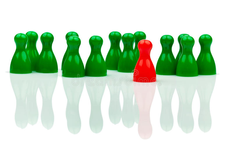 Bullying in the team. Outsider. Red and green characters. Bullying, loneliness and outsider in the team stock photo