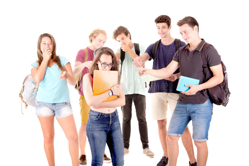 Bullying. Teenagers bullying another isolated in white royalty free stock photo