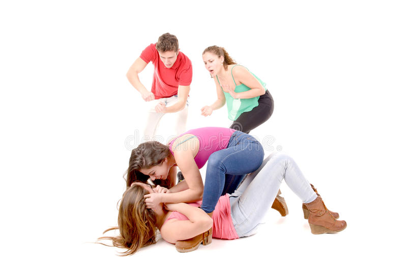 Bullying. Teenagers bullying a girl isolated in white background royalty free stock photos