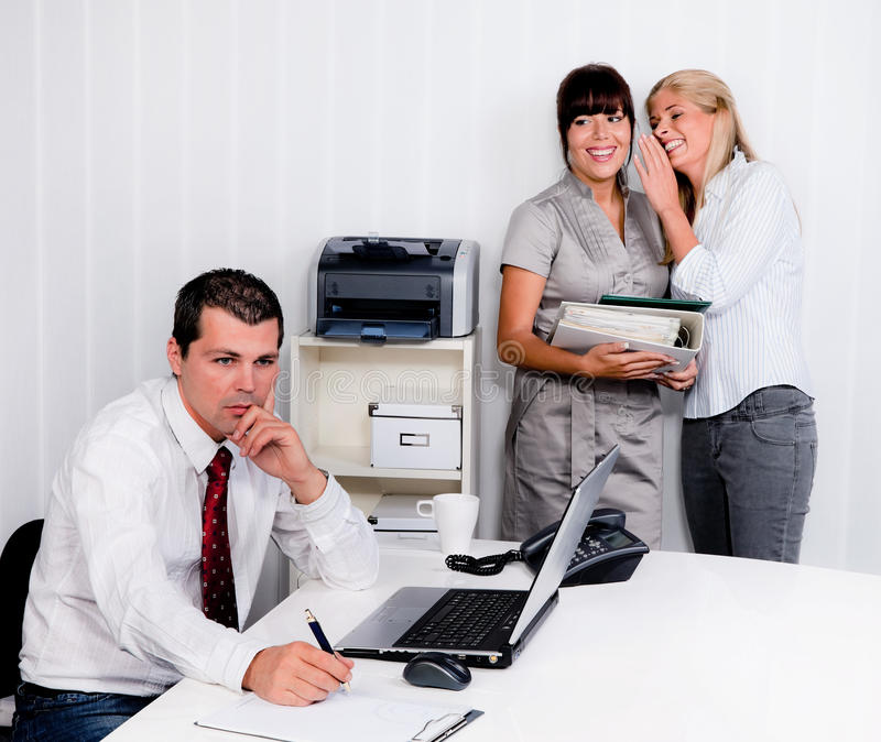 Bullying at work in the office stock images