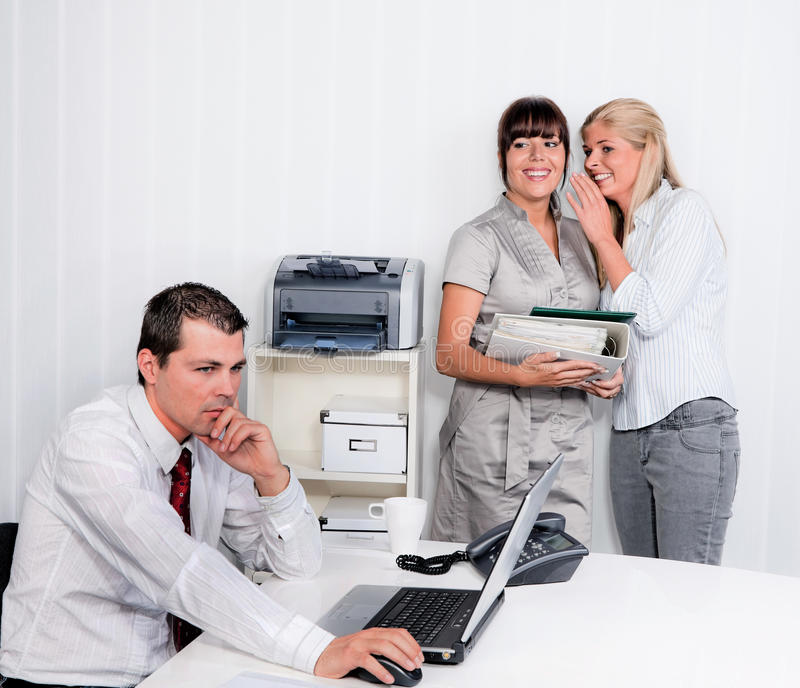 Bullying in the workplace office. Bullying in the workplace an office. Women make fun of men royalty free stock image