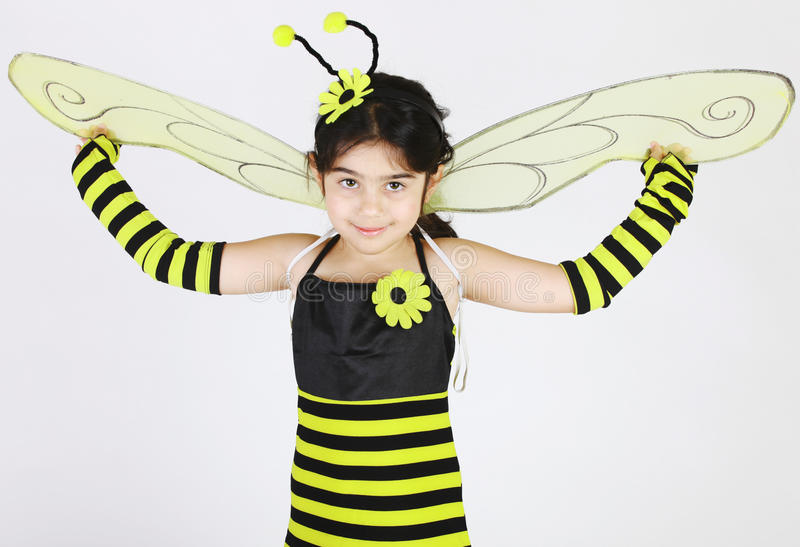 Bumble bee. Cute Little girl wearing a bee costume on white background stock image