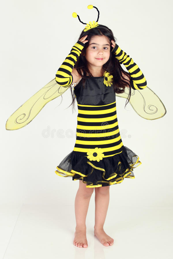 Bumble bee. Cute Little girl wearing a bee costume on white background royalty free stock photo