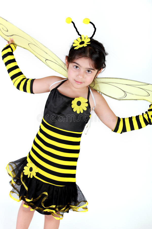 Bumble bee costume. Cute Little girl wearing a bee costume on white background stock images