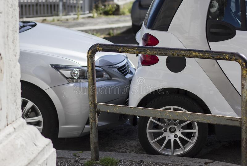 Bumper scrathing car trunk on a parking lot. Breaking rules. royalty free stock photography