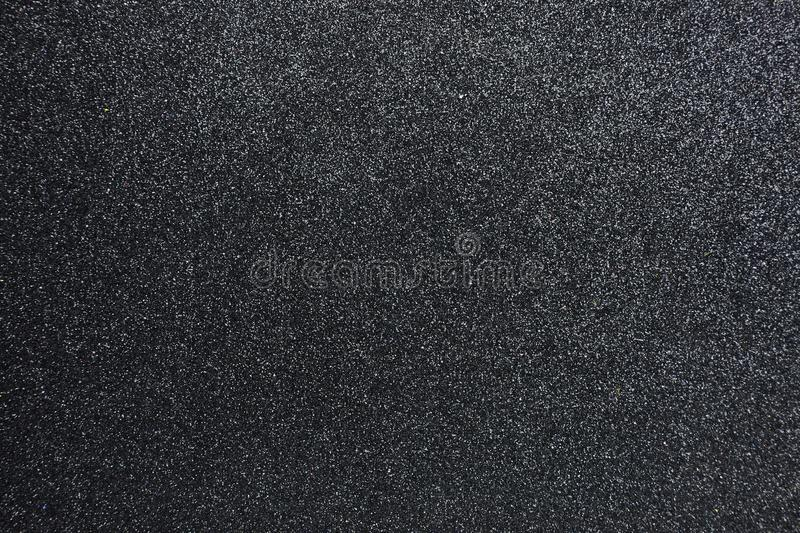 Bumpy black glitter textured background, Closeup royalty free stock images