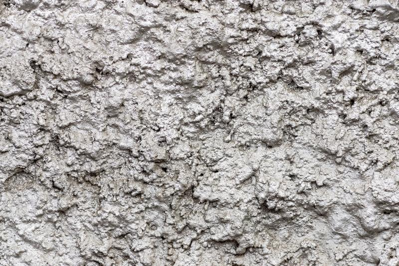 Bumpy shining wall surfaces of silvery color stock photos
