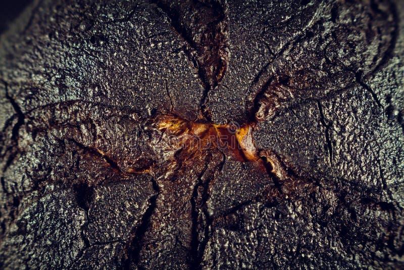 Bun burnt with a black crust. Coal close up. Wallpaper royalty free stock images