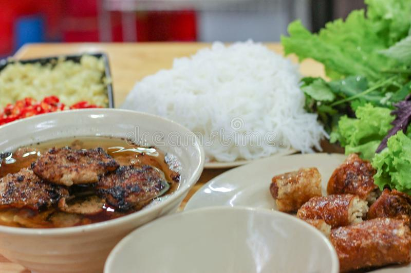 Bun cha, Vietnamese vermicelli with grilled pork served with fresh herbal stock image