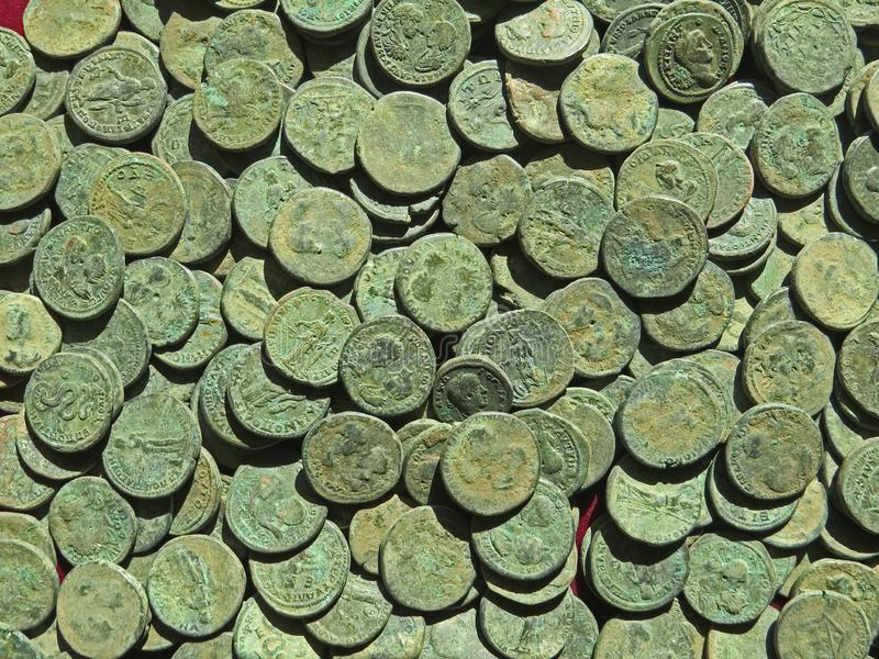 Ancient coin treasure. Stamped copper round money. Bunch of ancient coin treasure. Stamped copper round money royalty free stock images