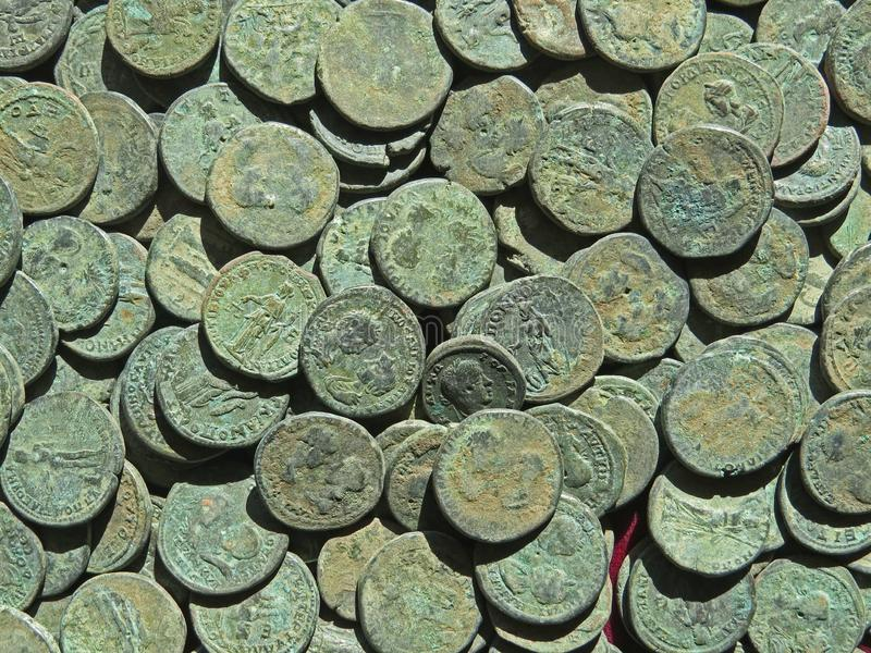 Ancient coin treasure. Stamped copper round money. Bunch of ancient coin treasure. Stamped copper round money stock photos